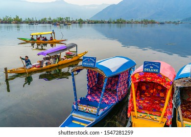 Srinagar,10 April ,2016 :  Top wide angle view  of Colorful Shikara boats in Dal Lake with mountains in background  .Famous destination for holidays, Kashmir, India , Asia
