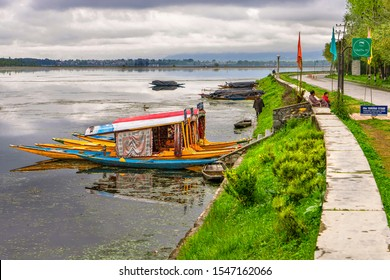 Srinagar,11 ,April ,2016 : Colorful  shikara boats  parked on Ghat No.24  of Dal Lake with mountains in background Famous destination  for tourists,  Kashmir,India , Asia