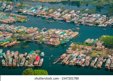 Srinagar,12 April ,2016 :Top view of    congested houseboats, shikaras, boats,  and houses  in blue waters of Dal Lake.   Famous destination  for tourists. Kashmir, India ,Asia