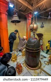 Srinagar,12,April ,2016,Kashmir India : Devotees  offering  prayers to Hindu God  Shiva in ancient Shankaracharya temple on hilltop ,Srinagar ,Jammu and Kashmir, India,Asia