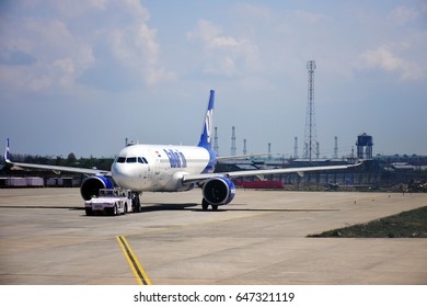 SRINAGARI, INDIA - 9 APR 2017 : GoAir plane parked at  Indira Gandhi International airport. It is a low-cost carrier based in Mumbai, India.