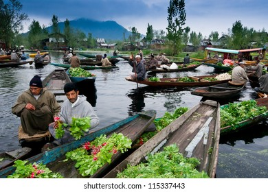 SRINAGAR,INDIA -APRIL 14: Lifestyle in Dal lake,Kashmiri men sell their vegetables at a floating market in the early hours before sunrise on April 14,2012 in Dal Lake, Srinagar,Jammu & Kashmir, India.