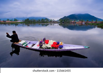 "SRINAGAR,INDIA-APRIL 14:  ""Mr. Wonderful"" The Kashmiri Flower Man makes his living sell beautiful flowers from his boat around the Dal Lake on April 14,2012 in Srinagar , Jammu & Kashmir state - India"