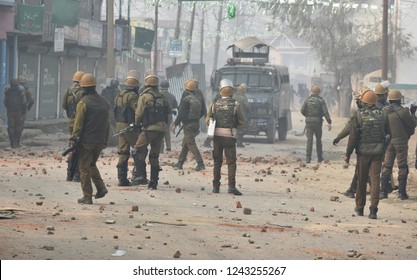Srinagar,Jammu&Kashmir,India 2018\11\28 :Kashmiri Muslim protesters during clashes with Indian police near the site of a gunfight were two militants were killed at district budgam