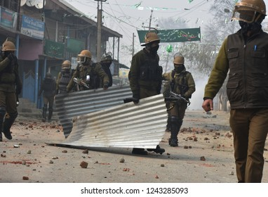 Srinagar,jammu&Kashmir,India 2018/11\28: police man clear the road  during clashes with protester near the site of a gunfight where two militants killed at Kuthpora area Budgam district,