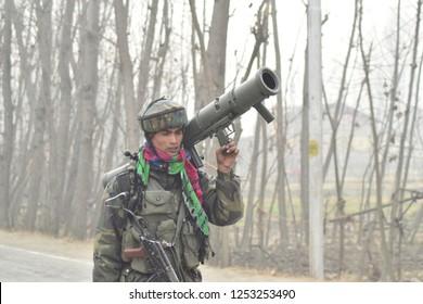 Srinagar,jammu&Kashmir,India 2018\12\09 :Indian army trooper carries Carl-Gustaf M4 (CGM4) 84mm portable, shoulder-at  gun battle where three militants were killed at Mujgund area outskirts of sgr