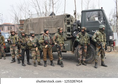 Srinagar,jammu&Kashmir,India 2018\12\09 :Indian army troopers stand alert near the gun battle site  between Indian armed forces and militants at Mujgund area on the outskirts of Srinagar