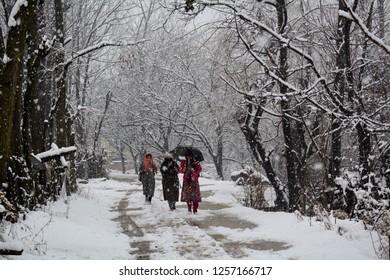 Srinagar,jammu&Kashmir,India 2018\12\13: kashmiri Muslim women walks on a snow covered road during heavy snow fall at qazigund in  South Kashmir