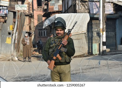 Srinagar,jammu&Kashmir,India 2018/12/16 : A paramilitary soldier stand guard. During restrictions in the several parts of Kashmir in Srinagar to thwart the protest against the killing of civilians