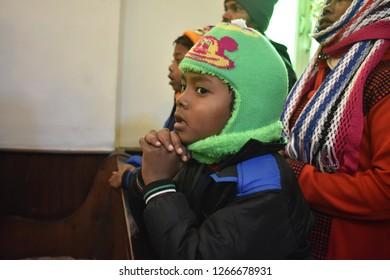 Srinagar,jammu&Kashmir,India 2018\12\25: A Christian little boy pray  at the Holy Family Catholic Church on Christmas Srinagar,Christians celebrate Christmas to commemorate the birth of Jesus