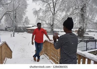 Srinagar,jammu&kashmir,India 2019\01\16:Touris clicking pictures  at local garden during fresh snowfall in Srinagar, . Kashmir received fresh snowfall