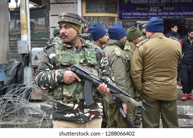 Srinagar,jammu&kashmir,India 2019\01\18: indian Security personnel stands guard after a grenade attack by suspected Militant.in the heart of a city in Srinagar at lalchowk