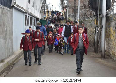 Srinagar,j&k,India,2019\03\11:School children  arrive on the first day in Srinagar, Schools across the Kashmir valley reopened after remaining closed for more than two months for winter break.