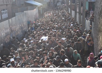 srinagar,j&k,india:2019\03\22 Kashmiri villagers carry the body of an 11-year-old boy, Aatif Mir, during his funeral procession in Hajin village, north of Srinagar