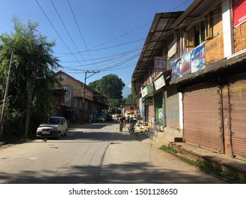 Srinigar / India - August 22 2019: Empty streets and closed shops in Srinagar on a late afternoon.