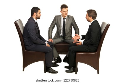 Srious conversation of three business men  sitting on chairs isolated on white background