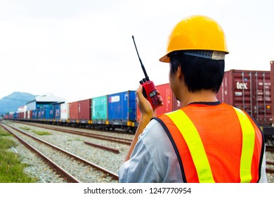 Sriracha, Chonburi THAILAND Dec 02, 2018: Shipping company worker contracting with containers train at shipping yard train station.