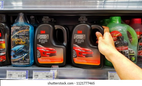 Sriracha, Chonburi THAILAND June 24, 2018: Man's hands are holding Car wash with Wax brand 3M in Hardware Stores. To clean his car.