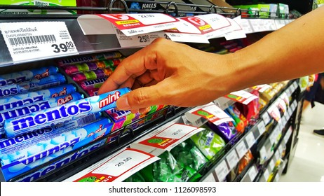 Sriracha, Chonburi THAILAND June 29, 2018: Man's hands are buying Candy brand Mentos in a supermarket.