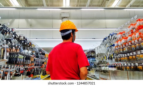 Sriracha, Chonburi THAILAND Nov  14, 2018: Worker is shopping equipment from supermarket shelf.