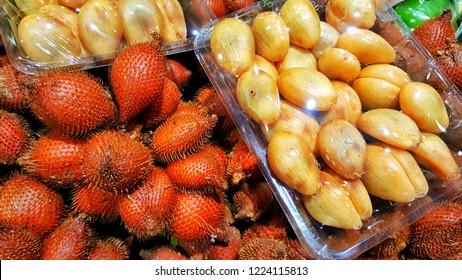 Sriracha, Chonburi THAILAND Nov  5, 2018: Fresh Salacca fruit (Salak fruit, Salacca wallichiana) display in supermaket shelf.