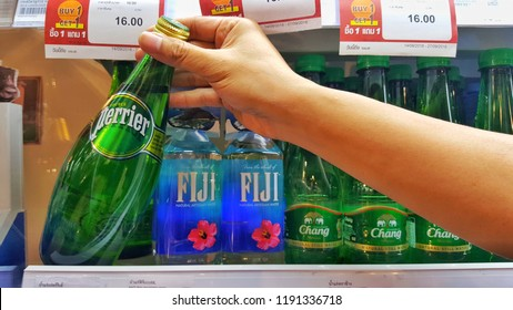 Sriracha, Chonburi THAILAND Sep 18, 2018: Man's hand is holding  mineral water bottle (perrier brand) from supermarket shelf