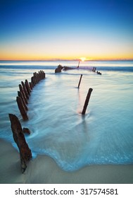 The SS Dicky at sunrise. Shipwrecked on Dicky Beach, Queensland, Australia.