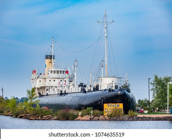 """SS Meteor(1896-1969) is the sole surviving ship of the unconventional """"whaleback"""" design. She is on the beach at Superior, Wisconsin"""