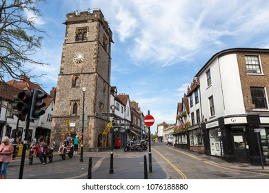 ST ALBANS, UK - AUGUST 28, 2017: View of the Clock Tower and street in the centre of St Albans. It has been claimed to be the only remaining medieval town belfry in England.