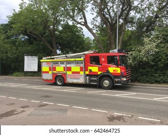 ST ALBANS, UK: MAY 18 2017: A British fire truck drives along a road.
