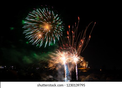 ST. ALBANS, UK - NOVEMBER 03, 2018: Fireworks display in Verulamium Park as a part of celebration of Bonfire night. In the background St. Albans Cathedral.