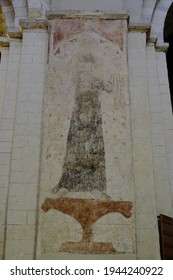 ST  ALBANS, UNITED KINGDOM - Nov 19, 2017: Defaced medieval mural painting of St Sitha  in St Albans Cathedral, UK