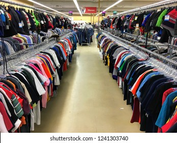 St. Albert, Alberta, Canada - November 25th, 2018: A colourful row of shirts for sale at the local Value Village, one of the most popular thrift stores to find all sorts of used goods.