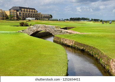 St Andrews, Fife, Scotland, UK  - June 18, 2018: Swilken Bridge over Swilcan Burn on the 18th Hole of the Old Course at St Andrews Links golf course the oldest in the world in St Andrews Scotland UK