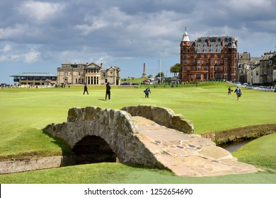 St Andrews, Fife, Scotland, UK  - June 18, 2018: The Royal and Ancient Golf Club of St Andrews clubhouse on the 18th Hole of Old Course St Andrews Links golf course at Swilken Brdige Scotland UK