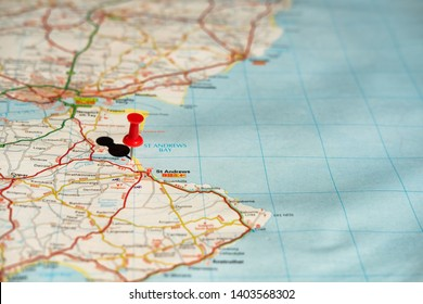 St Andrews, Scotland - Circa May 2019: Shallow focus of a red push-pin located at the famous, golf course of St Andrews. Some of the surrounding road network can also be seen on this route planner.