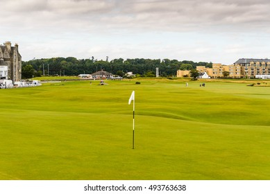 ST. ANDREWS, SCOTLAND--AUGUST 15, 2016--A foursome walking to the 18h hole of the golf course known as the Old Course in St. Andrews, Scotland.