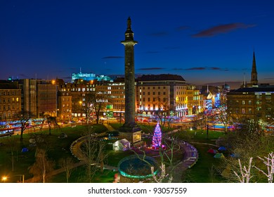 St Andrew's Square, Edinburgh, Scotland, UK, Europe, at dusk, at Christmas time.  The Melville monument is in the centre of the square.  The illuminated Castle is visible in the background.