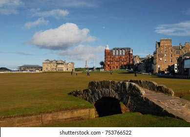 St. Andrews, United Kingdom - March 31, 2015: Swilcan bridge and The Royal and Ancient Clubhouse at the Old Course