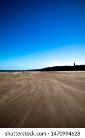 St Andrews west sands on a windy day.  The St Andrews skyline can be seen in the background.