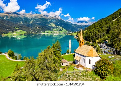 St. Anna Chapel and Submerged Bell Tower of Curon at Graun im Vinschgau on Lake Reschen in South Tyrol, Italy