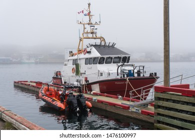 St. Anthony, Newfoundland, Canada - June 15, 2019: Canadian Coast Guard ship, Pennant Bay, sits docked in St. Anthony, Newfoundland, Canada on a foggy day. High endurance search and rescue ship.