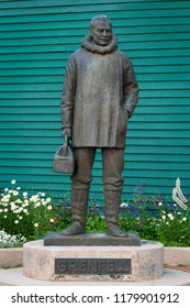 ST. ANTHONY, NEWFOUNDLAND/CANADA - AUGUST 1, 2018:  Dr. Wilfred Grenfell statue in front of the Interpretation Centre on West Street in St. Anthony