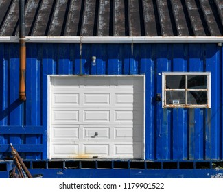ST. ANTHONY, NEWFOUNDLAND/CANADA - JULY 31, 2018: Exterior of coloful royal blue shed and garage on Moore's Drive in St. Anthony