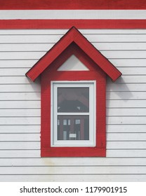 ST. ANTHONY, NEWFOUNDLAND/CANADA - JULY 31, 2018: Closeup of a red and white window of the Fox Point (Fishing Point) Lighthouse on West Street in St. Anthony