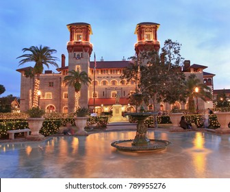 ST. AUGUSTINE, FLORIDA - DECEMBER 24, 2017 : Lightner Museum and Town Square (Alcazar Square) in St Augustine illuminated at dusk, Christmas time.