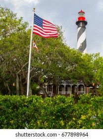 The St. Augustine, Florida, lighthouse with the museum and American flag waving in the foreground