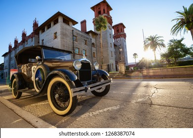 St. Augustine, Florida, United States - October 30, 2018: Old Collectible Ford Vintage Car parked in front of Lightner Museum during a sunny sunset.