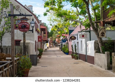 ST AUGUSTINE, FLORIDA, USA - AUGUST, 2017: A pedestrianized street lined with shops and attractions in the Historic District stands empty waiting for summer tourists.