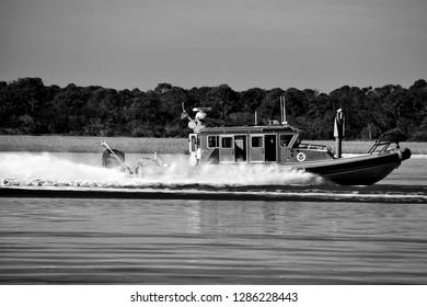ST. AUGUSTINE, FLORIDA, USA - NOVEMBER 06, 2018: Homeland Security, Border Patrol vessel cruising on the river protecting the coastline of Florida